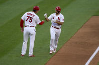 St. Louis Cardinals' Paul DeJong, right, is congratulated by third base coach Ron 'Pop' Warner (75) after hitting a two-run home run during the fifth inning in the first game of a baseball doubleheader against the New York Mets Wednesday, May 5, 2021, in St. Louis. (AP Photo/Jeff Roberson)