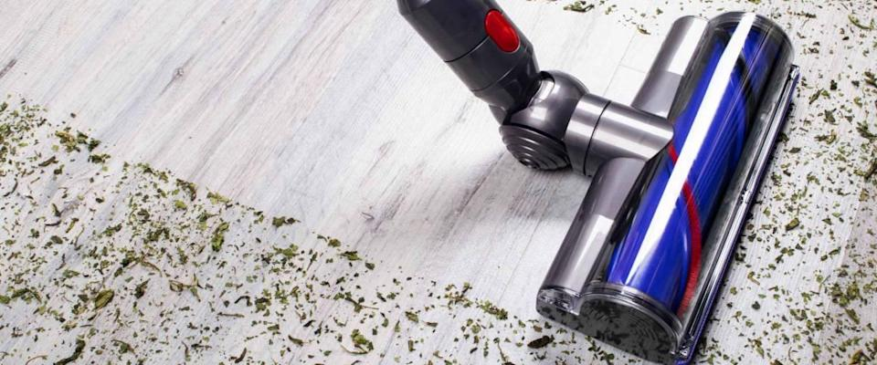 Vacuum cleaner on the floor. House cleaning concept. Before and after cleaning. Dirty and cleaned area. Housekeeping. Modern vacuum cleaner while vacuuming. Cleaning service