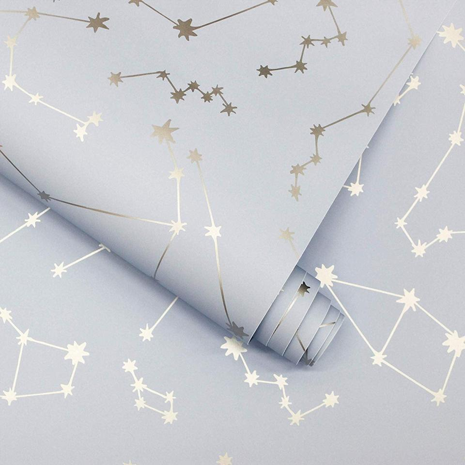<p>This gleaming <span>Novogratz Constellations Removable Peel and Stick Wallpaper</span> ($35, originally $40) is positively dreamy.</p>