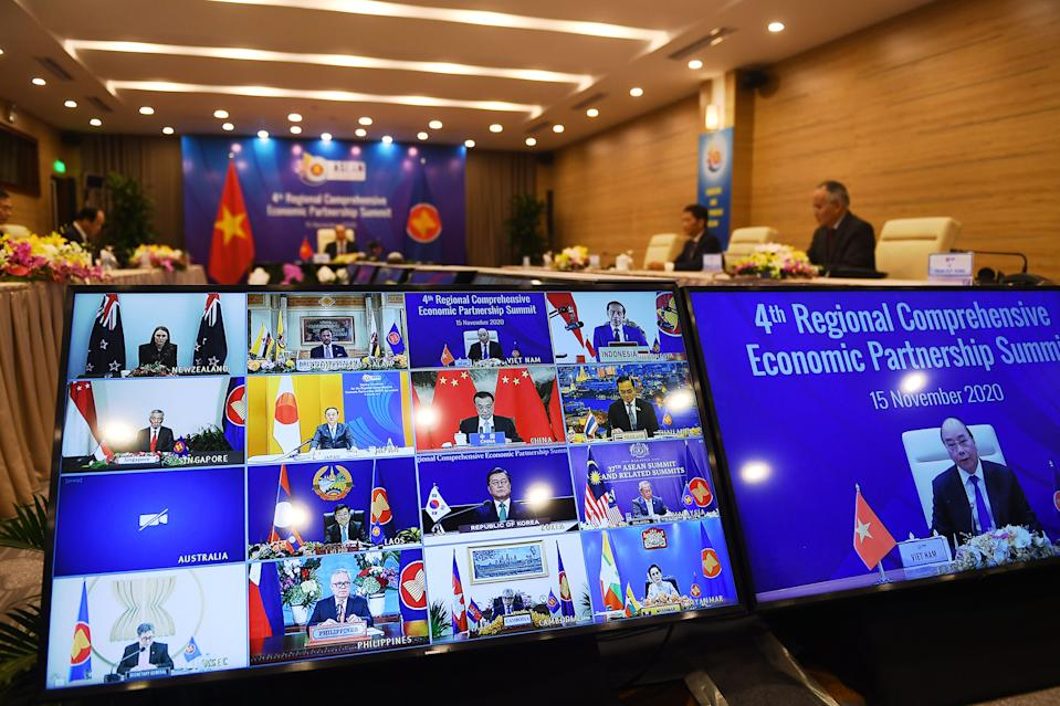 Vietnam's Prime Minister Nguyen Xuan Phuc is pictured on the screen (R) as he addresses his counterparts during the 4th Regional Comprehensive Economic Partnership (RCEP) Summit at the Association of Southeast Asian Nations (ASEAN) summit being held online in Hanoi on November 15, 2020. (Photo by Nhac NGUYEN / AFP) (Photo by NHAC NGUYEN/AFP via Getty Images)