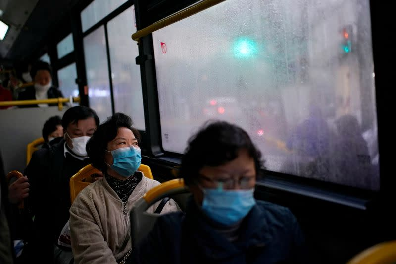 People wearing face masks are seen on a bus amid the global outbreak of the coronavirus disease (COVID-19) in Shanghai
