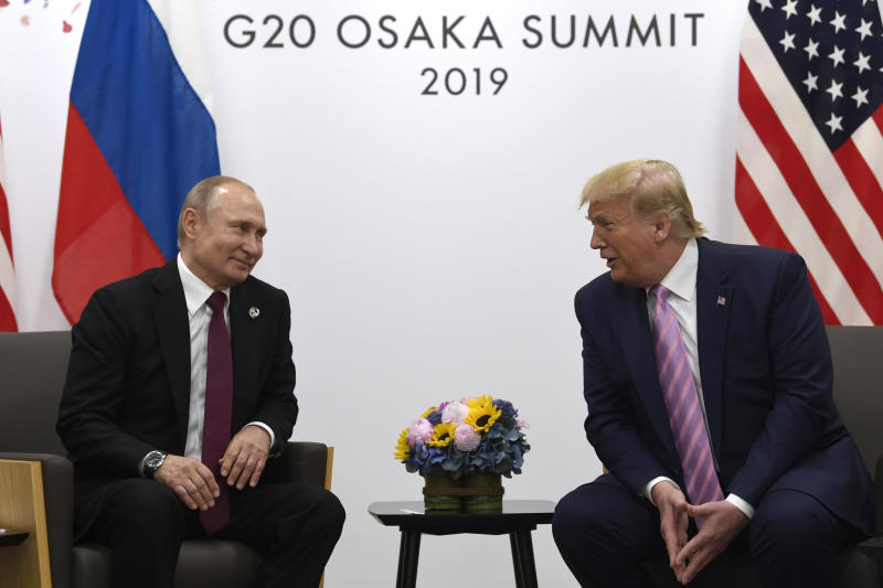 FILE - In this June 28, 2019, file photo, President Donald Trump, right, meets with Russian President Vladimir Putin during a bilateral meeting on the sidelines of the G-20 summit in Osaka, Japan. Delegations from the U.S. and Russia are meeting this week to discuss arms control and the possibility of coaxing China into negotiating a new, three-way nuclear weapons pact, two senior administration officials said Monday, July 15, 2019. (AP Photo/Susan Walsh, File)