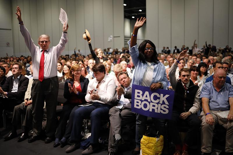 Supporters hold placards as Conservative MP and leadership contender Boris Johnson speaks at the final Conservative Party leadership election hustings in London, on July 17, 2019. - The battle to become Britain's next prime minister enters the home straight on Wednesday with both candidates hardening their positions on Brexit, putting the future government on a collision course with Brussels. (Photo by Tolga Akmen / AFP) (Photo credit should read TOLGA AKMEN/AFP/Getty Images)