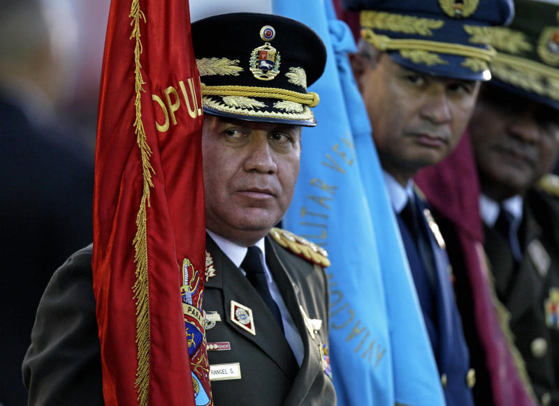 FILE - In this Jan. 17, 2012 file photo, Venezuela's Defense Minister Gen. Henry Rangel Silva attends his swearing-in ceremony at Fort Tiuna military base in Caracas, Venezuela. The shadow of the Venezuelan military hangs over Sunday's presidential election, with many people wondering how the armed forces might react if Chavez stumbles in his fight to stay in power.(AP Photo/Fernando Llano, File)