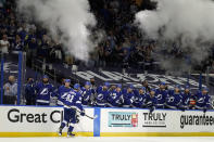 Tampa Bay Lightning center Steven Stamkos (91) celebrates with the bench after his goal against the Carolina Hurricanes during the second period in Game 4 of an NHL hockey Stanley Cup second-round playoff series Saturday, June 5, 2021, in Tampa, Fla. (AP Photo/Chris O'Meara)