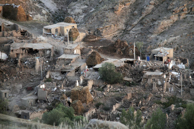 Damaged buildings are seen in a village near the city of Varzaqan in northwestern Iran, on Sunday, Aug. 12, 2012. Twin earthquakes in Iran have killed at least 250 people and injured over 2,000, Iranian state television said on Sunday, after thousands spent the night outdoors after their villages were leveled and homes damaged in the country's northwest. Iran is located on seismic fault lines and is prone to earthquakes. It experiences at least one earthquake every day on average, although the vast majority are so small they go unnoticed. (AP Photo/ISNA, Farshid Tighehsaz)