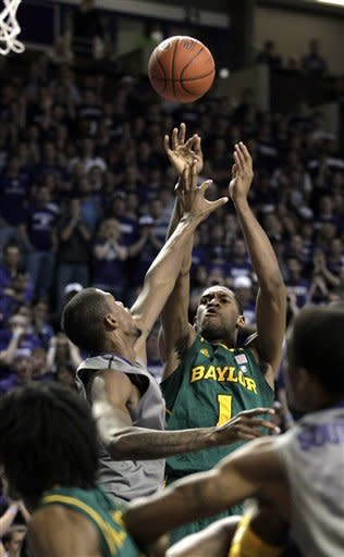 Baylor's Perry Jones III (1) puts up a shot under pressure from Kansas State center Jordan Henriquez (21) during the first half of an NCAA college basketball game, Tuesday, Jan. 10, 2012, in Manhattan, Kan. (AP Photo/Charlie Riedel)