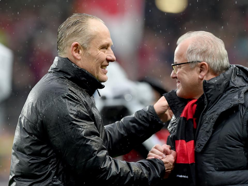FREIBURG GERMANY - APRIL 4: Headcoach Christian Streich (L) and President Fritz Keller of SC Freiburg celebrates after the Bundesliga match between Sport Club Freiburg and 1. FC Koeln at Schwarzwald-Stadium on April 4, 2015 in Freiburg, Germany.  (Photo by Michael Kienzler/Bongarts/Getty Images)