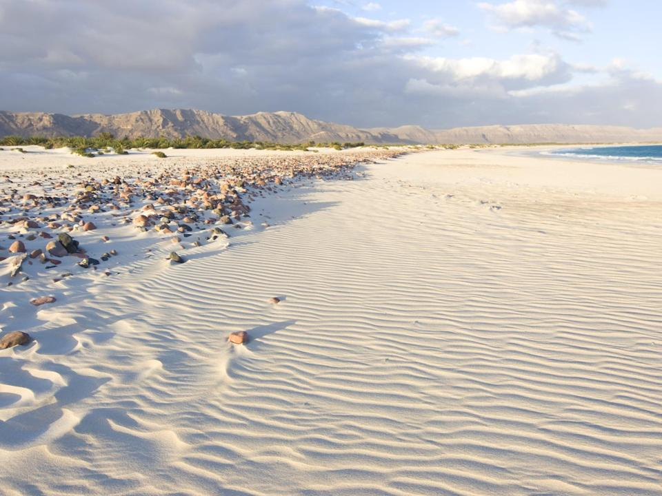 <p>On the Socotra island of Yemen, you'll see some of the most unreal-looking sand dunes - so white, they look like talcum powder from a distance.</p>