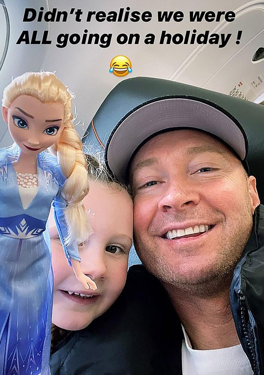 Michael Clarke, pictured here with daughter Kelsey-Lee on a plane.