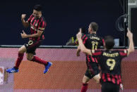 Atlanta United midfielder Gonzalo Martinez, left, celebrates after scoring a goal during the first half of an MLS soccer match against Nashville SC on Saturday, Aug. 22, 2020, in Atlanta. (AP Photo/Brynn Anderson)