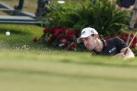 Patrick Cantlay hits out of a bunker on the 18th hole during the third round of the Tour Championship golf tournament Saturday, Sept. 4, 2021, at East Lake Golf Club in Atlanta. (AP Photo/Brynn Anderson)