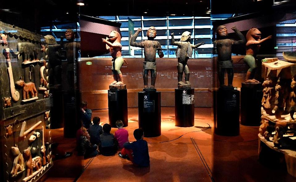 """Benin's artefacts from the era of the Kingdom of Dahomey, including these royal statues, are among 70,000 African objects kept at the Musée du quai Branly-Jacques Chirac in Paris -- but France says it plans to return 26 works plundered in 1892 """"without delay"""" (AFP Photo/GERARD JULIEN)"""