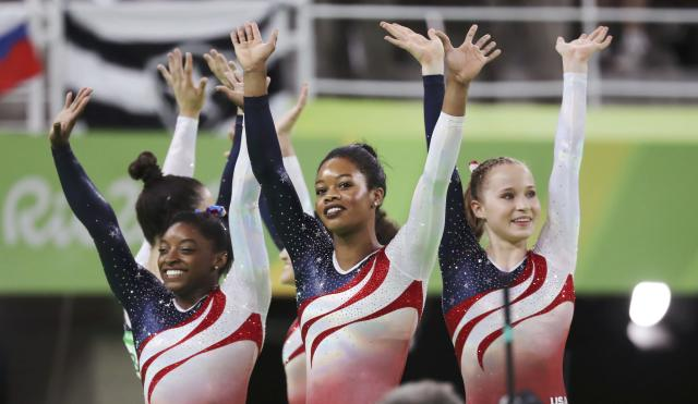 2016 Rio Olympics - Artistic Gymnastics - Final - Women's Team Final - Rio Olympic Arena - Rio de Janeiro, Brazil - 09/08/2016. Simone Biles (USA) of USA (L), Gabrielle Douglas (USA) of USA (Gabby Douglas) (C), Madison Kocian (USA) of USA (R), Alexandra Raisman (USA) of USA (Aly Raisman) (back) and Laurie Hernandez (USA) of USA (back) celebrate winning the gold in the women's team final. REUTERS/Damir Sagolj TPX IMAGES OF THE DAY. FOR EDITORIAL USE ONLY. NOT FOR SALE FOR MARKETING OR ADVERTISING CAMPAIGNS.