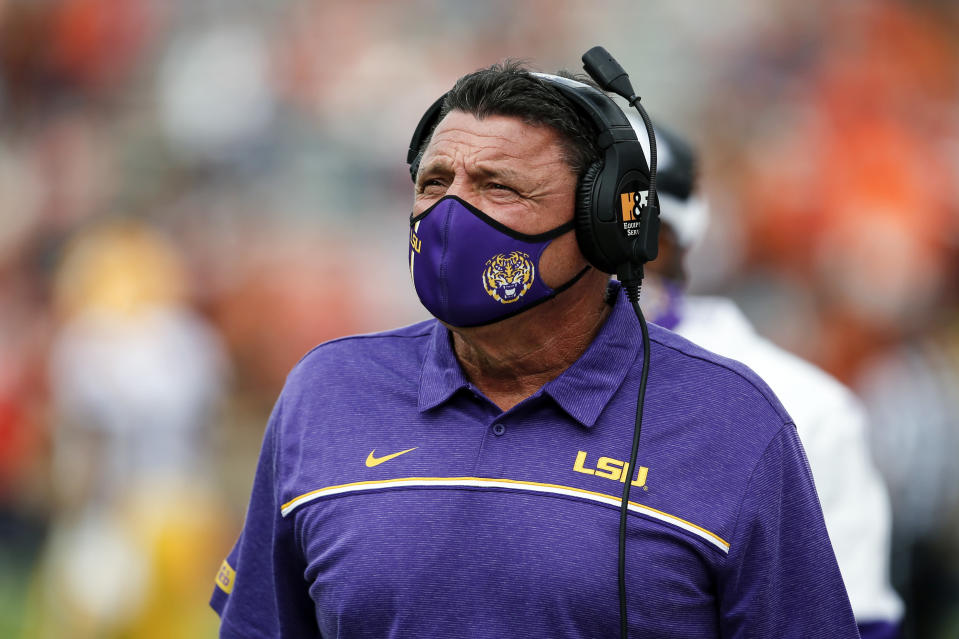 LSU head coach Ed Orgeron walks the sideline during the first quarter of an NCAA college football game against Auburn on Saturday, Oct. 31, 2020, in Auburn, Ala. (AP Photo/Butch Dill)