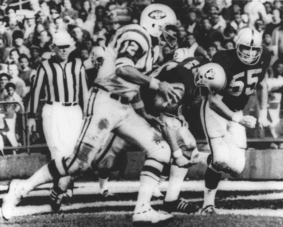 """FILE - In this Nov. 17, 1968, file photo, New York Jets' quarterback Joe Namath (12) sweeps around the right side past Oakland Raider defenders Ralph Oliver (56) and Dan Conners (55) to score from the one-yard line during the second quarter of a football game at Oakland Coliseum in Oakland, Calif. The Jets were leading 32-29 when the childrens classic """"Heidi"""" began on NBC, interrupting the final minutes of the game which the Raiders won 43-32 in one of the most dramatic rallies in AFL history. (AP Photo/File)"""