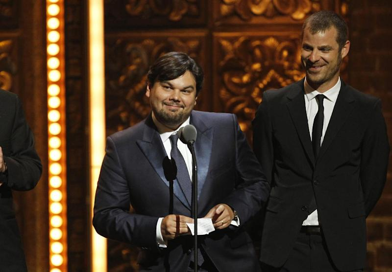 "FILE - This June 12, 2011 file photo shows songwriter Robert Lopez, left, and Matt Stone accepting the award for Best Book of a Musical for ""The Book of Mormon"" during the 65th annual Tony Awards in New York. Lopez, who helped create ""Avenue Q"" and ""The Book of Mormon,"" is up for an Academy Award next month along with his co-writing partner and wife, Kristen Anderson-Lopez, for best song for ""Let it Go"" from the animated film ""Frozen."" (AP Photo/Jeff Christensen, File)"