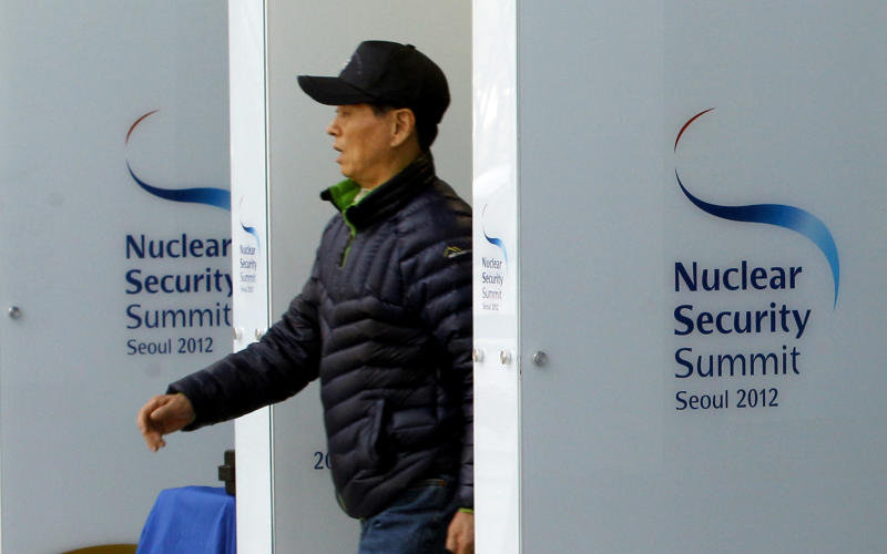 A man passes through a security gate at the venue for the Nuclear Security Summit in Seoul, South Korea, Wednesday, March 21, 2012. The summit will be held in Seoul from March 26 to 27. (AP Photo/Lee Jin-man)