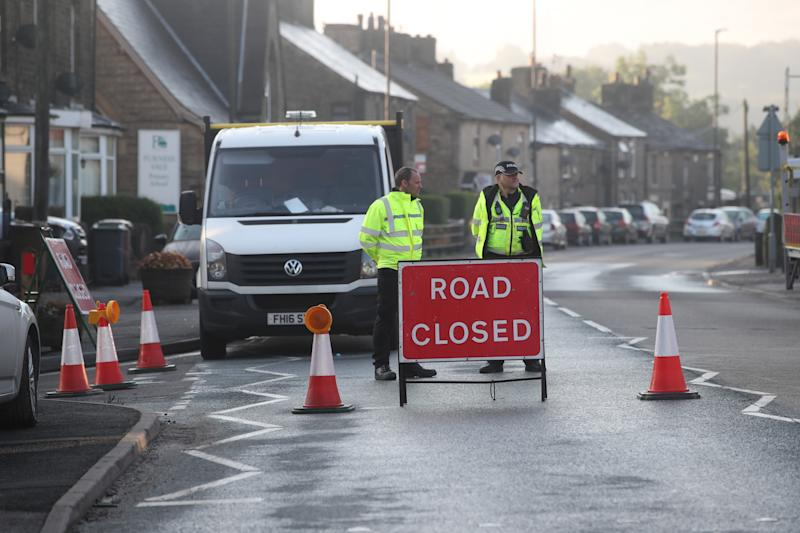 A roadblock on the outskirts of Whaley Bridge in Derbyshire which was evacuated while attempts continue to repair the dam at nearby Toddbrook Reservoir after it was damaged in heavy rainfall.