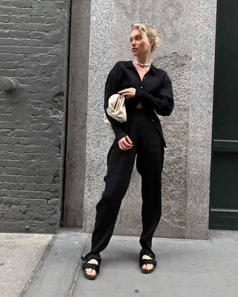 "<p>We love this louche take on the black suit—for when you want to be super comfortable but still pulled together.</p><p><a href=""https://www.instagram.com/p/CAvU17AJhwU/?utm_source=ig_embed&utm_campaign=loading"" rel=""nofollow noopener"" target=""_blank"" data-ylk=""slk:See the original post on Instagram"" class=""link rapid-noclick-resp"">See the original post on Instagram</a></p>"