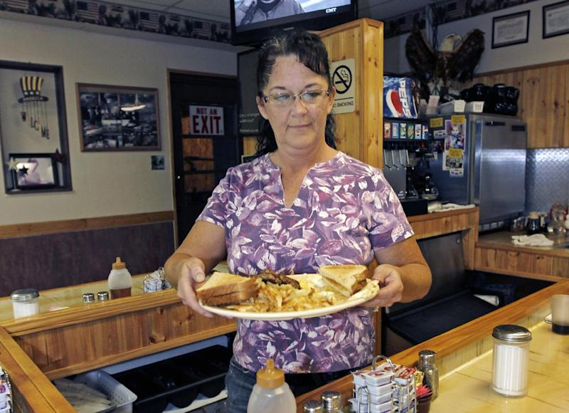 FILE-In this Thursday, Sept. 27, 2012, file photo, Millie Brown, a cook and waitress at Buch's truck stop, serves a breakfast, in Steubenville, Ohio. U.S. service companies, which employ nearly 90 percent of the work force, grew in September at the fastest pace since March. The growth was driven by sharp increases in current and future sales.  The Institute for Supply Management said Wednesday, Oct. 3, 2012, that its index of non-manufacturing activity rose to 55.1, up from 53.7 in August.  (AP Photo/Keith Srakocic, File)