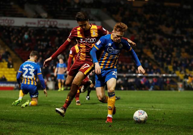 "Soccer Football - League One - Bradford City vs Shrewsbury Town - Northern Commercials Stadium, Bradford, Britain - April 12, 2018 Bradford City's Alex Gilled in action with Shrewsbury's Jon Nolan Action Images/Lee Smith EDITORIAL USE ONLY. No use with unauthorized audio, video, data, fixture lists, club/league logos or ""live"" services. Online in-match use limited to 75 images, no video emulation. No use in betting, games or single club/league/player publications. Please contact your account representative for further details."