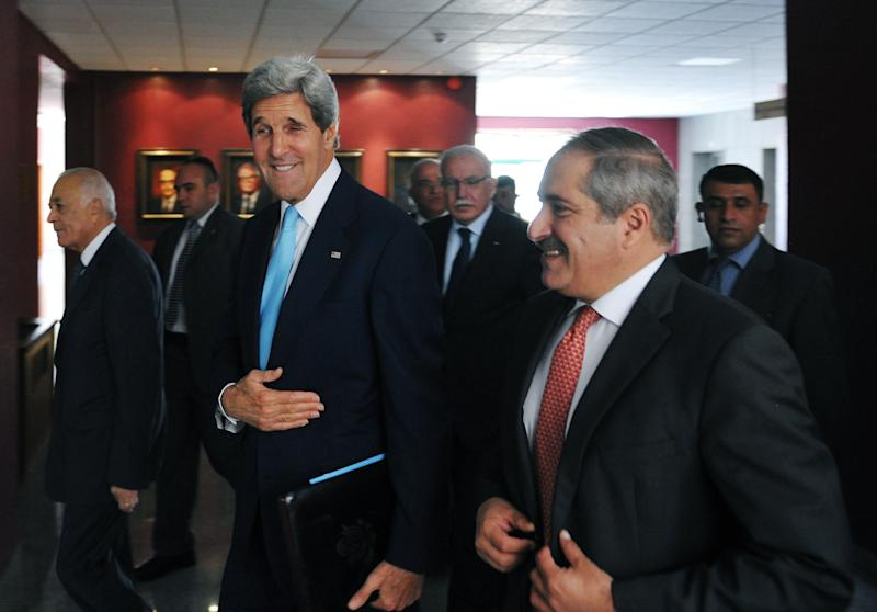 U.S. Secretary of State John Kerry, center, Jordan's Foreign Minister Nasser Judeh, right, and Egypt's Foreign Minister Mohammed Kamel Amr, left, arrive for a meeting with the Arab League Peace Initiative at the Ministry of Foreign Affairs in Amman, Jordan, on Wednesday, July 17, 2013. Kerry is briefing senior Arab officials on his efforts to restart Israeli-Palestinian peace talks and on American views of the crises and Syria and Egypt. (AP Photo/Mandel Ngan, Pool)