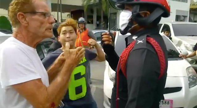 The Thai man throws a punch hitting Gerard Collins. Source: Newsflare