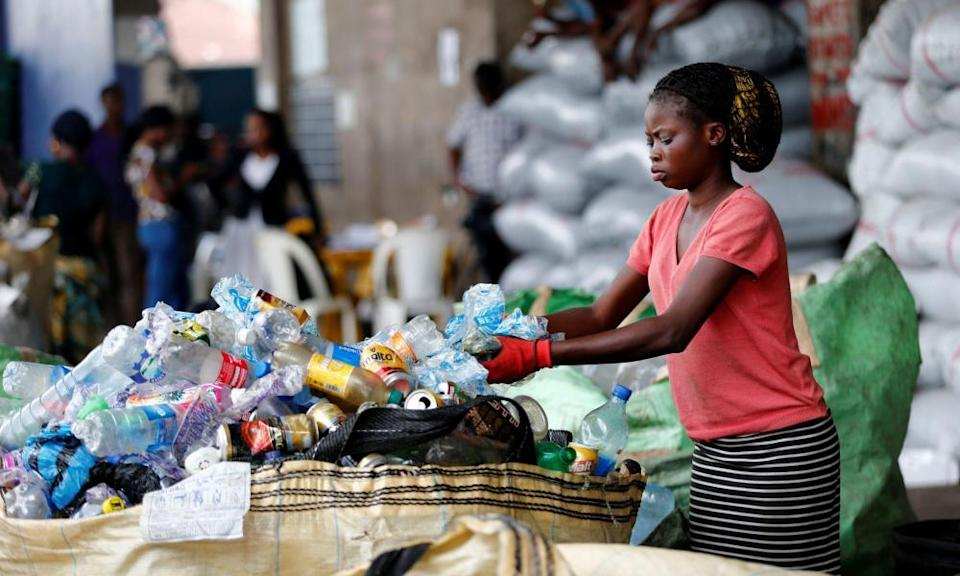 An worker sorts waste at a recycling centre in Lagos