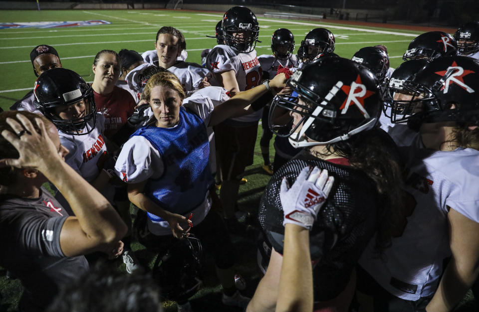 Revere - July 15: The Boston Renegades women's football team comes in for a huddle at the conclusion of the teams practice at the Harry della Russo Stadium in Revere, MA on Thursday night, July 15, 2021. The women's football team has qualified for the national championship game in Ohio and is aiming for a third straight title. (Photo by Erin Clark/The Boston Globe via Getty Images)
