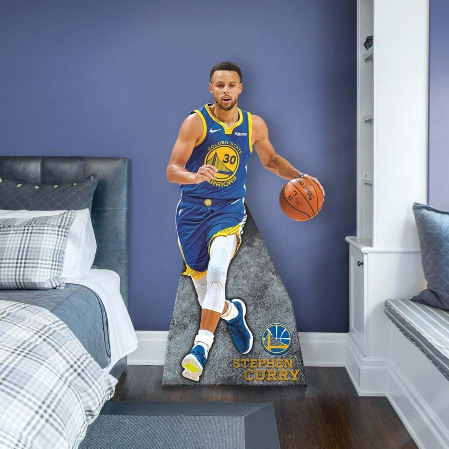 <p>If your tween loves the NBA MVP, this <span>Steph Curry Life-Size Cut Out</span> ($100) is a no-brainer for their bedroom.</p>