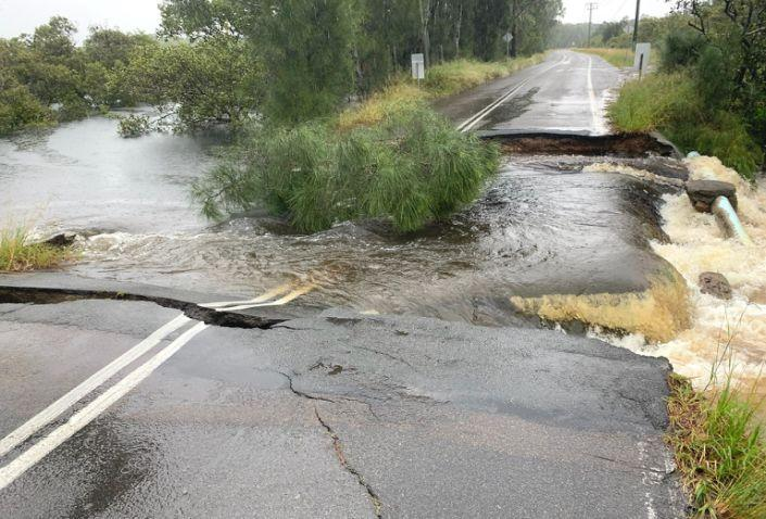 A road washed away by heavy floodwaters in Port Stephens.