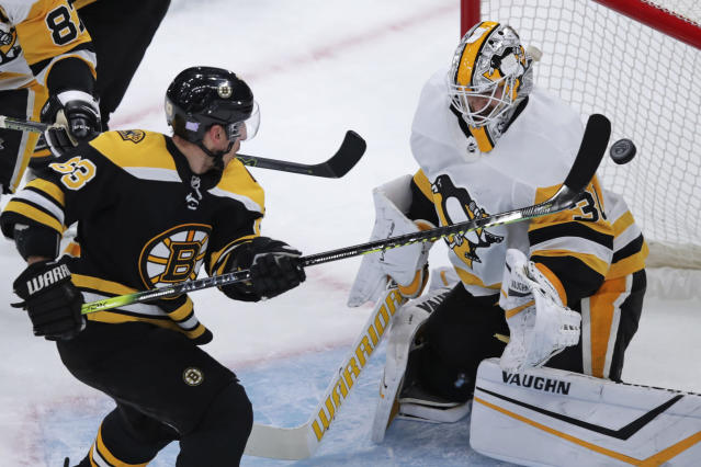 Boston Bruins center Brad Marchand (63) tips the puck past Pittsburgh Penguins goaltender Matt Murray for a goal during the first period of an NHL hockey game in Boston, Monday, Nov. 4, 2019. (AP Photo/Charles Krupa)