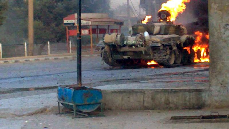 In this citizen journalism image provided by The Syrian Revolution against Bashar Assad which has been authenticated based on its contents and other AP reporting, a Syrian military tank caught on fire during clashes with Free Syrian army fighters in Joubar a suburb of Damascus, Syria, Wednesday, Sept. 4, 2013. The United States is considering launching a punitive strike against the regime of Syrian President Bashar Assad, blamed by the U.S. and the Syrian opposition for an Aug. 21 alleged chemical weapons attack in a rebel-held suburb of the Syrian capital of Damascus. (AP Photo/The Syrian Revolution against Bashar Assad)