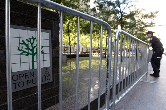 A police officer stands guard outside metal barricades surrounding Zuccotti park, Saturday, Sept. 15, 2012 in New York. The Occupy Wall Street movement will mark it's first anniversary on Monday. (AP Photo/Mary Altaffer)