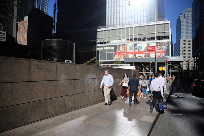 <p>People make their way back to the office during the lunch hour on Cortlandt Street across from the World Trade Center site on Aug. 23, 2016. (Gordon Donovan/Yahoo News) </p>