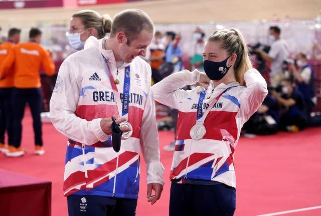 Great Britain's Laura Kenny and Jason Kenny with their silver medals at the Izu Velodrome
