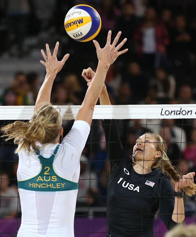 Tamsin Hinchley, left, form Australia tries to block Kerri Walsh, right, of US during their Beach Volleyball match at the 2012 Summer Olympics, Saturday, July 28, 2012, in London. (AP Photo/Petr David Josek)
