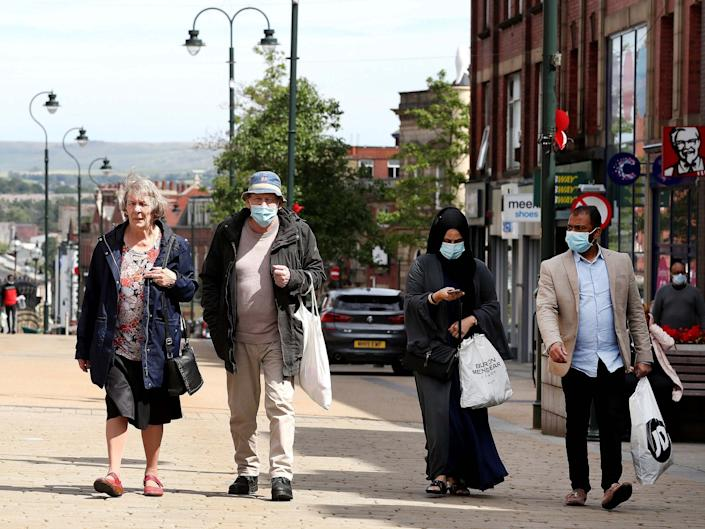 People shopping in Oldham, Greater Manchester, where there has been a rise in coronavirus cases, 30 July 2020: Martin Rickett/PA
