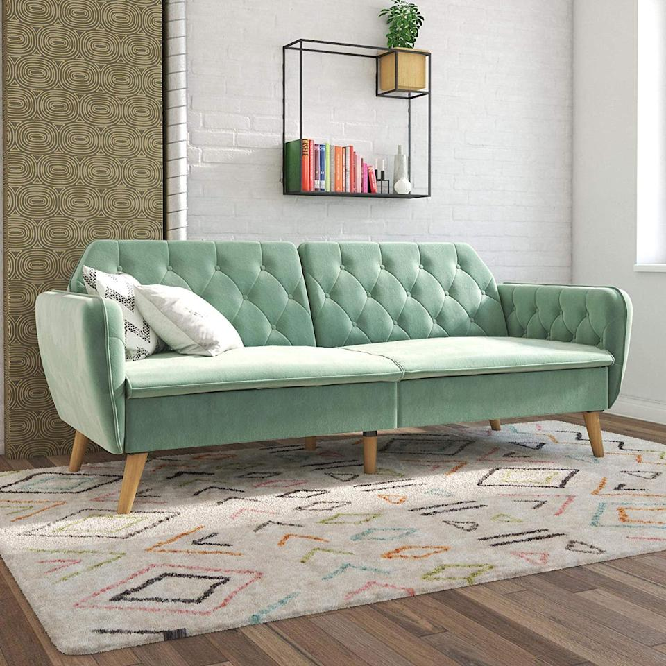 "<p>Yes, this <a href=""https://www.popsugar.com/buy/Novogratz-Tallulah-Memory-Foam-Sofa-Bed-507434?p_name=Novogratz%20Tallulah%20Memory%20Foam%20Sofa%20Bed&retailer=amazon.com&pid=507434&price=380&evar1=casa%3Aus&evar9=45945172&evar98=https%3A%2F%2Fwww.popsugar.com%2Fhome%2Fphoto-gallery%2F45945172%2Fimage%2F46811667%2FNovogratz-Tallulah-Memory-Foam-Sofa-Bed&list1=shopping%2Camazon%2Cfurniture%2Csofas%2Cliving%20rooms%2Chome%20shopping&prop13=mobile&pdata=1"" rel=""nofollow"" data-shoppable-link=""1"" target=""_blank"" class=""ga-track"" data-ga-category=""Related"" data-ga-label=""https://www.amazon.com/dp/B07THG63LT/ref=dp_cerb_3?th=1"" data-ga-action=""In-Line Links"">Novogratz Tallulah Memory Foam Sofa Bed</a> ($380, originally $400) also turns into a bed. Plus, it comes in tons of colors.</p>"