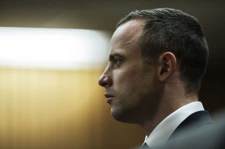 South African Olympic and Paralympic track star Oscar Pistorius sits in the dock, during the trial for the murder of his girlfriend Reeva Steenkamp, in the North Gauteng High Court in Pretoria