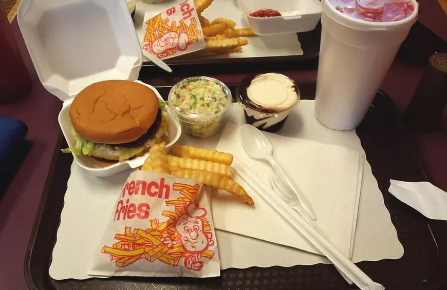 """<p>Dizzy Whizz is a true family-owned establishment and has been since it opened its doors in the late 1940s. This Louisville favorite has curbside service, where you can order classic diner fare like steak hoagies, <a href=""""https://www.thedailymeal.com/eat/best-chicken-sandwiches-america?referrer=yahoo&category=beauty_food&include_utm=1&utm_medium=referral&utm_source=yahoo&utm_campaign=feed"""" rel=""""nofollow noopener"""" target=""""_blank"""" data-ylk=""""slk:fried chicken sandwiches"""" class=""""link rapid-noclick-resp"""">fried chicken sandwiches</a> and tuna salad. The signature item is the Whizzburger, which comes complete with two burger patties, a special sauce, lettuce and cheese.</p>"""