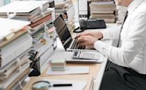 """It's natural to hoard your work. But the best employees—those of <a rel=""""nofollow noopener"""" href=""""https://bestlifeonline.com/born-leader/?utm_source=yahoo-news&utm_medium=feed&utm_campaign=yahoo-feed"""" target=""""_blank"""" data-ylk=""""slk:the corner office caliber—"""" class=""""link rapid-noclick-resp"""">the corner office caliber—</a>have mastered the art of delegation. Your coworkers are there to help, especially if they're below you on the food chain. Don't neglect that. Once you can let go of any neurotic tendencies about how, exactly, you like things done, you'll be able to accomplish a lot more during your day."""