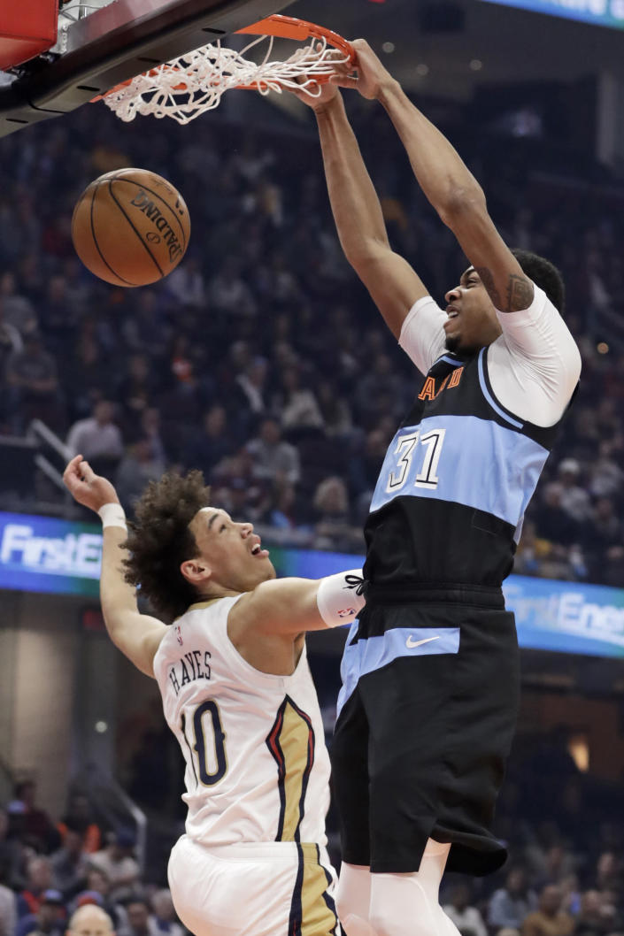 Cleveland Cavaliers' John Henson (31) dunks next to New Orleans Pelicans' Jaxson Hayes (10) during the first half of an NBA basketball game Tuesday, Jan. 28, 2020, in Cleveland. (AP Photo/Tony Dejak)