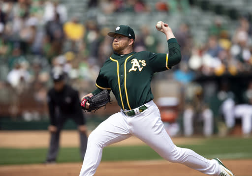 Oakland Athletics starting pitcher Brett Anderson delivers against the San Francisco Giants during the third inning of an exhibition baseball game, Sunday, March 24, 2019, in Oakland, Calif. (AP Photo/D. Ross Cameron)
