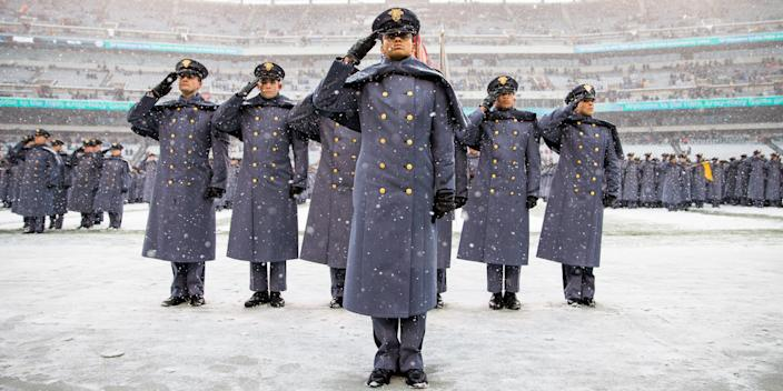 Simone Askew, first captain of the Corps of Cadets, leads the chant before a game between the Army Black Knights and the Navy Midshipmen at Lincoln Financial Field in Philadelphia, December 9, 2017.