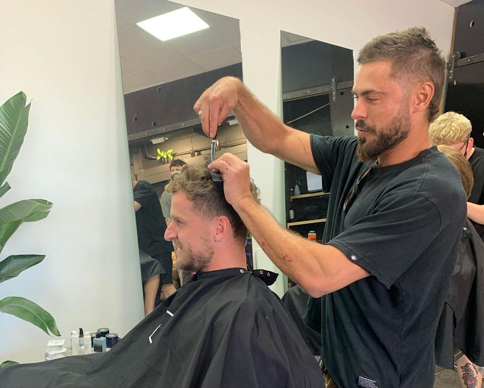 Zac even gave owner Robby Lippett a little trim while he was there. Photo: Instagram/Atta Boy Hair
