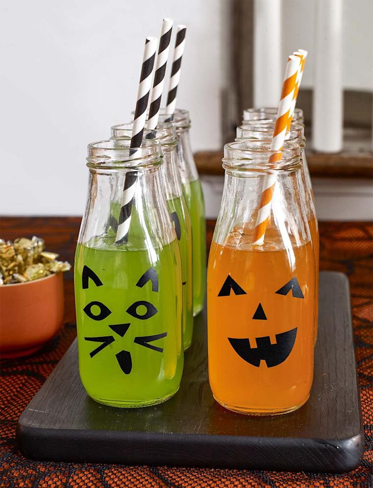 "<p>All it takes is a little contact paper and a savvy template to turn mini milk bottles in festive drinking vessels for your party.</p><p><strong><a rel=""nofollow"" href=""https://www.womansday.com/home/crafts-projects/g22840971/halloween-2018-templates/"">Get the template.</a></strong></p><p><strong>What you'll need: </strong>black contact paper ($10, <a rel=""nofollow"" href=""https://www.amazon.com/Magic-Cover-Self-Adhesive-Contact-18-inches/dp/B0170QPEB6/"">amazon.com</a>)</p>"