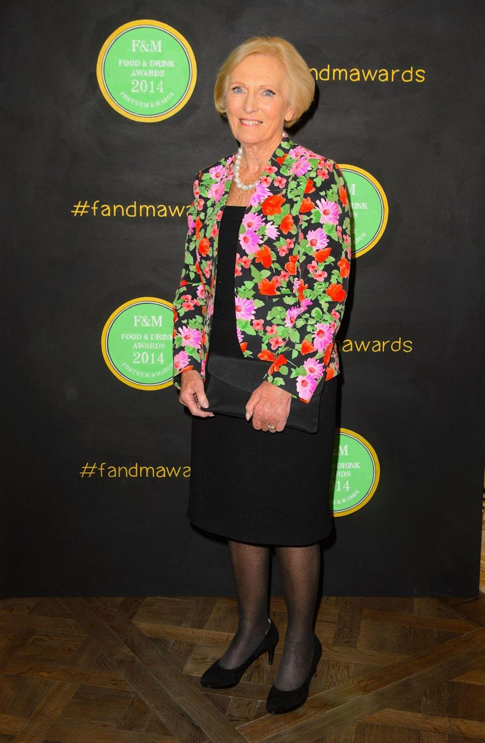 <p>The presenter donned yet another bright floral design for an awards show.</p><p><i>[Photo: PA] </i></p>