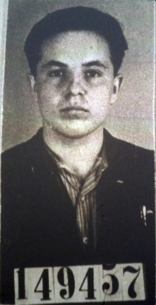 FILE - This undated file photo shows Michael Karkoc, which was part of his application for German citizenship filed with the Nazi SS-run immigration office on Feb. 14, 1940. Karkoc, a retired Minnesota carpenter whom The Associated Press exposed as a former commander of a Nazi-led unit accused of war atrocities, died Dec. 14, 2019, according to cemetery and public records. He was 100. His family maintained that he was never a Nazi or committed any war crimes. (U.S. National Archives via AP, File)